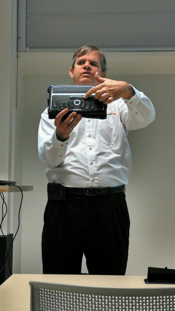 Dan Brown from HumanWare showed a BrailleNote device that allows him to work with a computer.