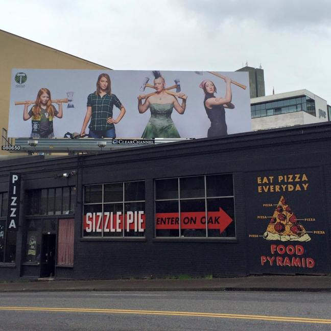Portland Timbers billboard at Sizzle Pizza. Pizza food pyramid mural.