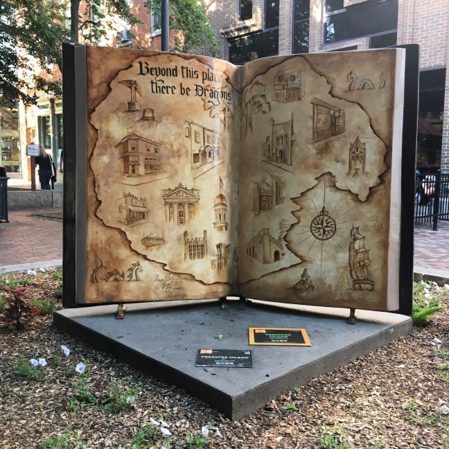 Photograph of a giant sculpture of a book in a streetscene